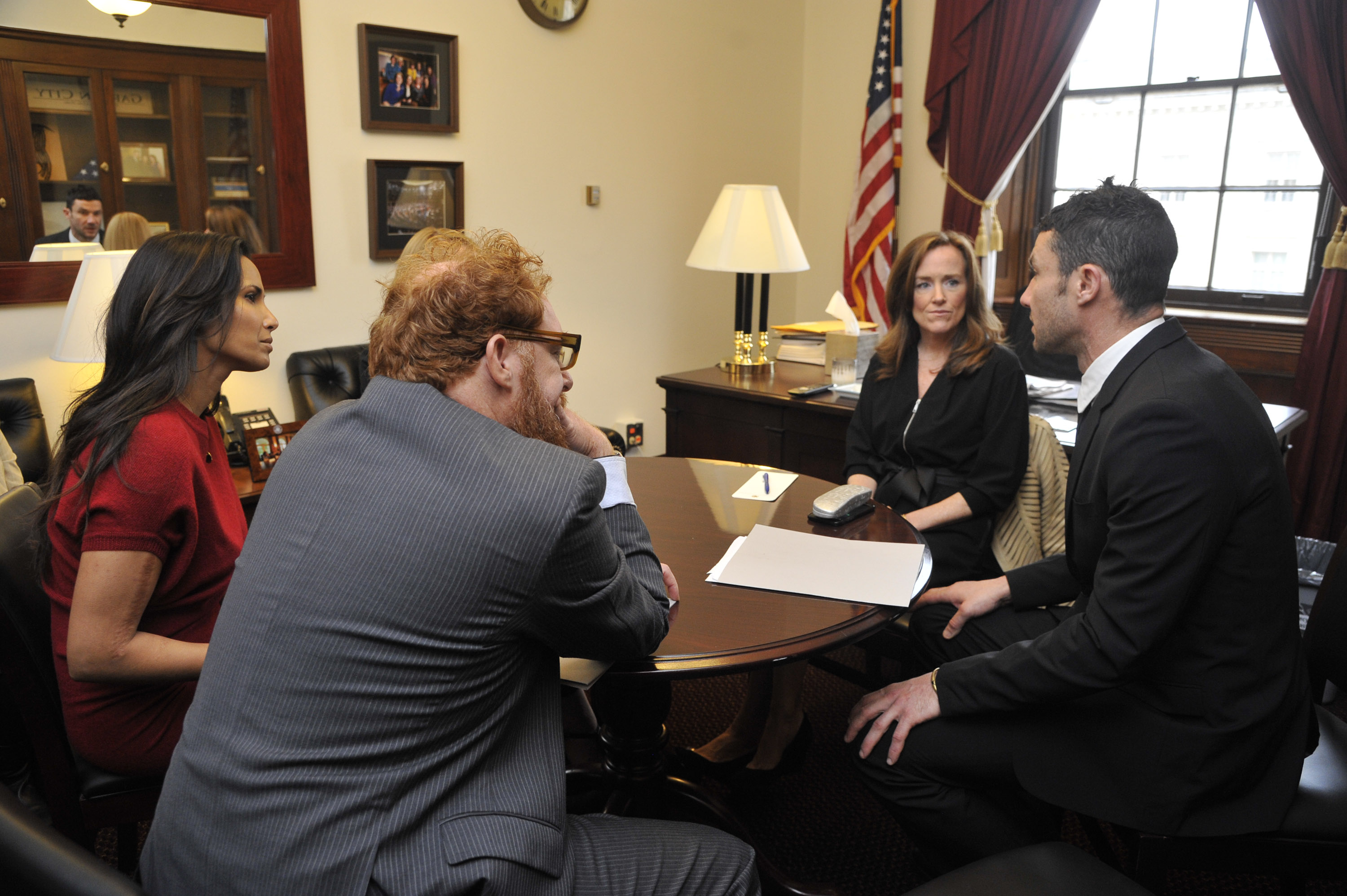 "Chefs Sam Talbot , Jennifer Pulapaka, Matt Weingarten and Top Chef Host Padma Lakshmi speak with Rep. Kathleen Rice (D-NY) about school lunches as part of ""Chef Day of Action"" in the Longworth House Office Building on October 27, 2015 in Washington, DC. (Photo Courtesy of Kris Connor/Getty Images for Chef Action Network)"