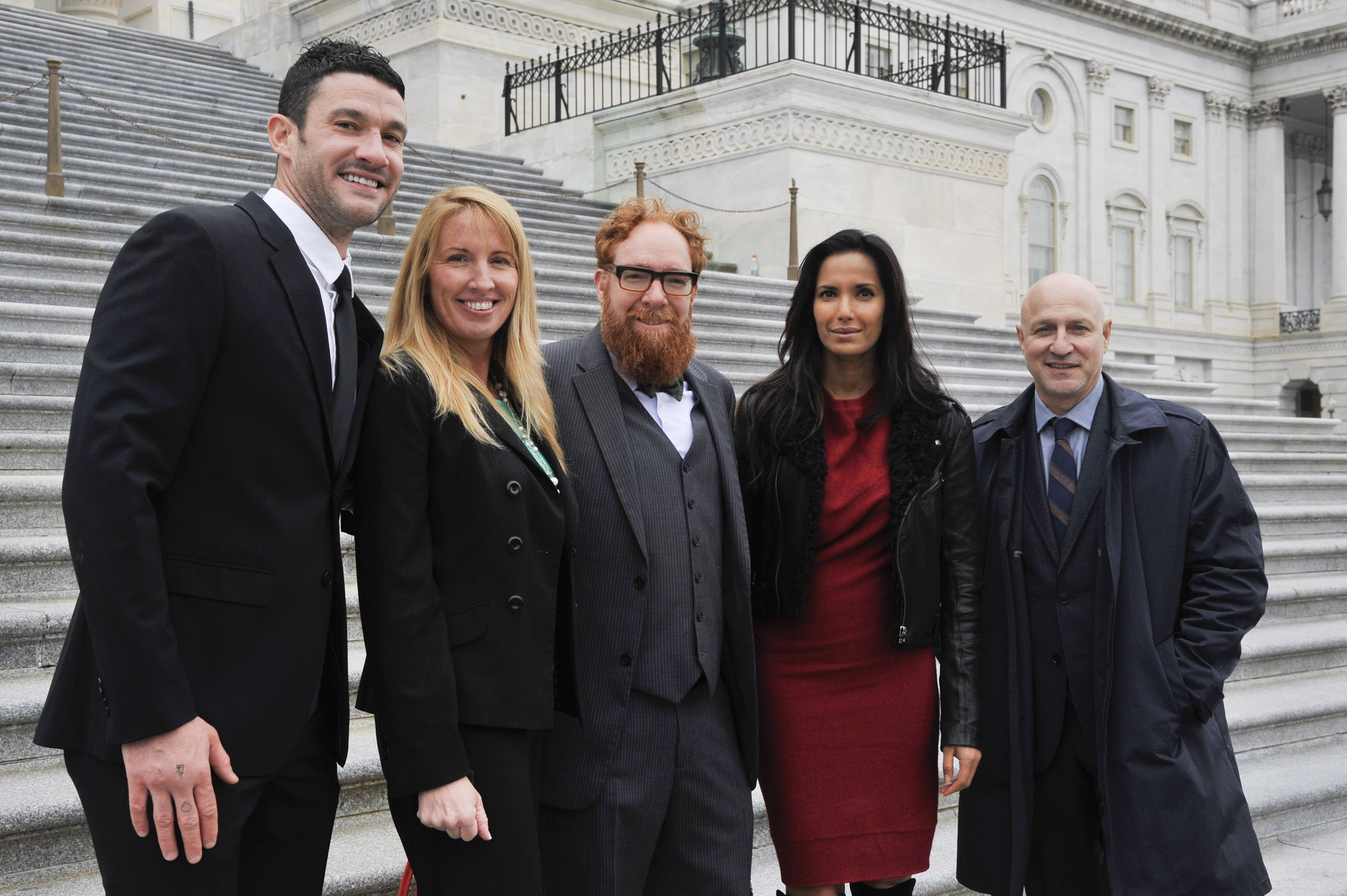 Chefs Sam Talbot, Jennifer Pulapaka, Matt Weingarten, Top Chef Host Padma Lakshmi and Chef Tom Colicchio pose for a photo on the capitol steps as they came together on Capitol Hill for a day of action and advocacy with about 30 other chefs on October 27, 2015 in Washington, DC. (Photo Courtesy of Kris Connor/Getty Images for Chef Action Network)